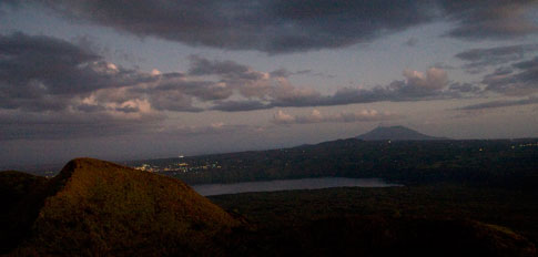 Picture: Twilight view of Masaya city and Mombacho Volcano, seen from the Masaya Volcano
